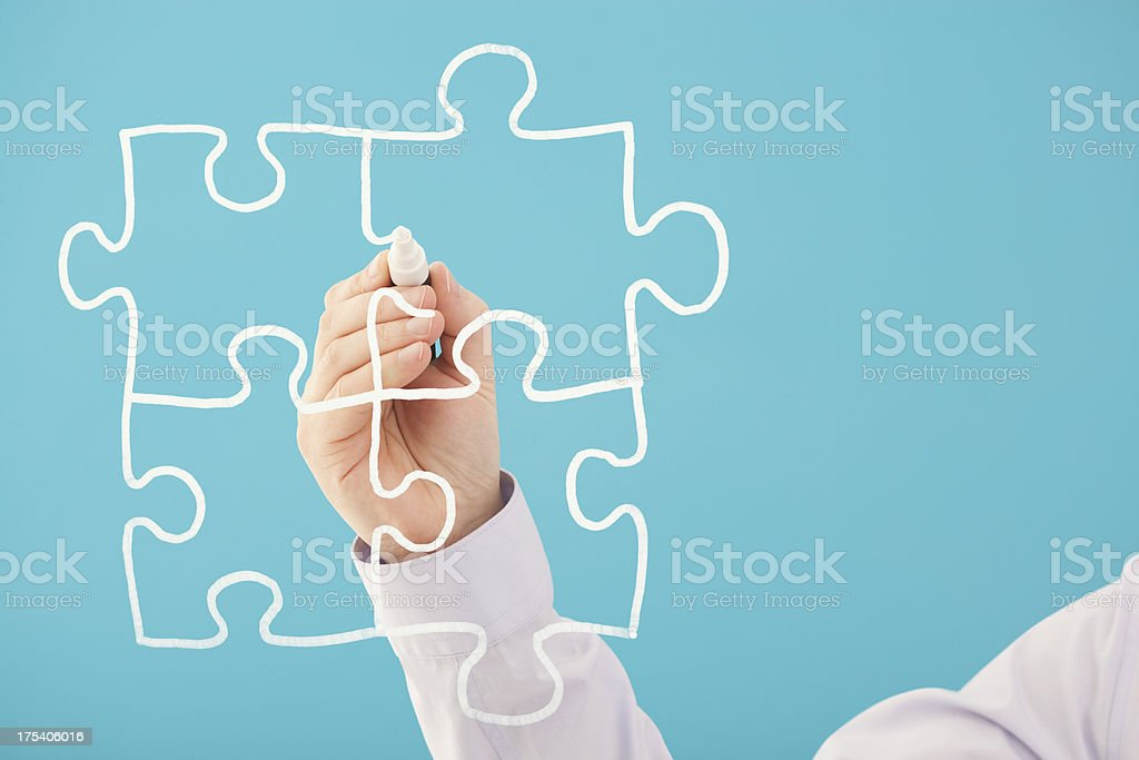 Jigsaw pieces hand drawn on screen royalty-free stock photo