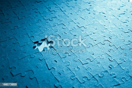 istock Jigsaw Puzzle And Missing Piece 166073655