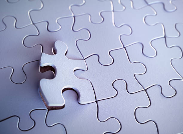 Jigsaw Puzzle Featured Piece Blank puzzle with one featured piece. Concept of solution and highlight. jigsaw piece stock pictures, royalty-free photos & images