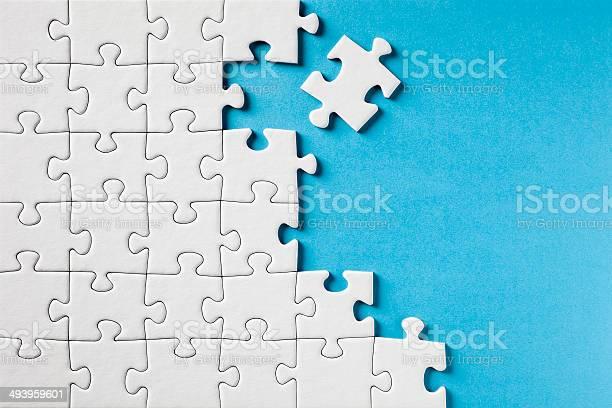 Jigsaw puzzle on blue picture id493959601?b=1&k=6&m=493959601&s=612x612&h=ujnawmg6lei3kc ieqxihbfdtle3zfoska6wj86cxgu=