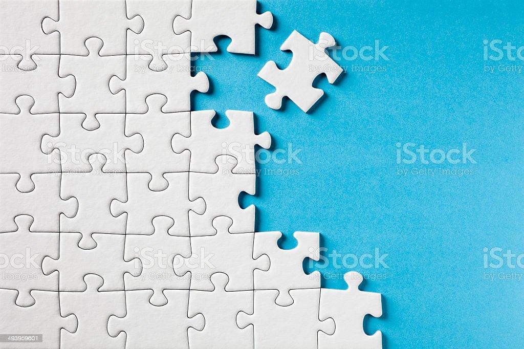 jigsaw piece. jigsaw puzzle on blue stock photo piece