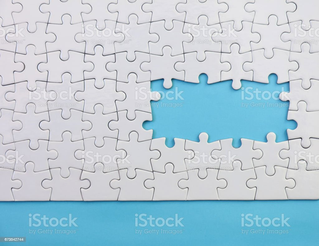 Jigsaw Puzzle on Blue royalty-free stock photo