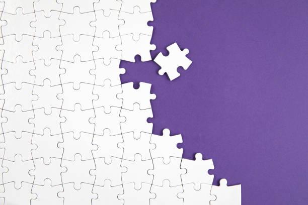 Jigsaw Puzzle on Purple Background stock photo