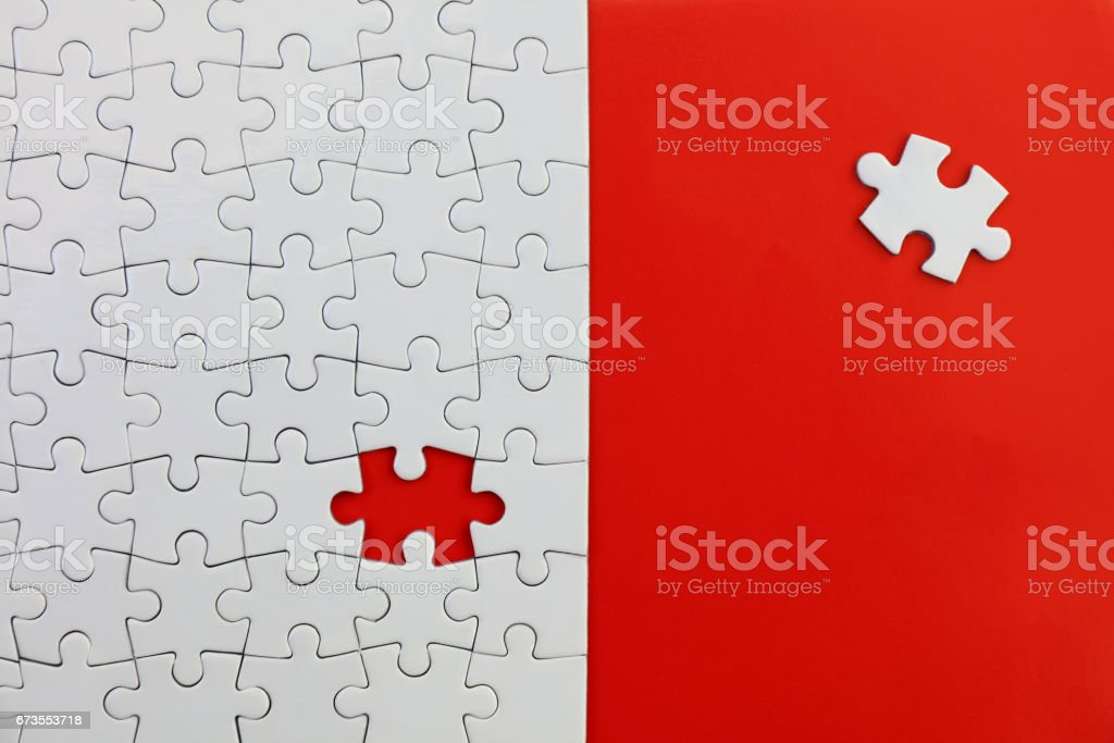Jigsaw Puzzle on Red royalty-free stock photo