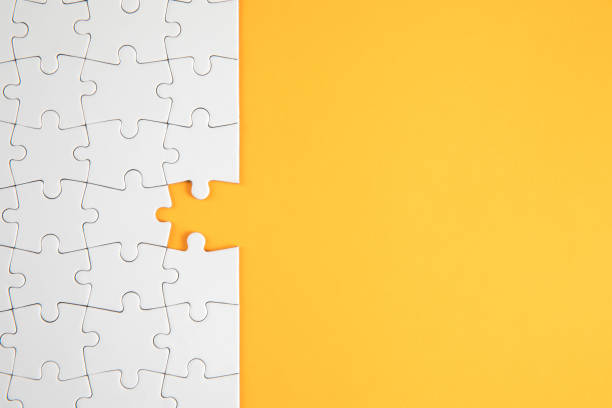 Jigsaw Puzzle on Yellow Background stock photo