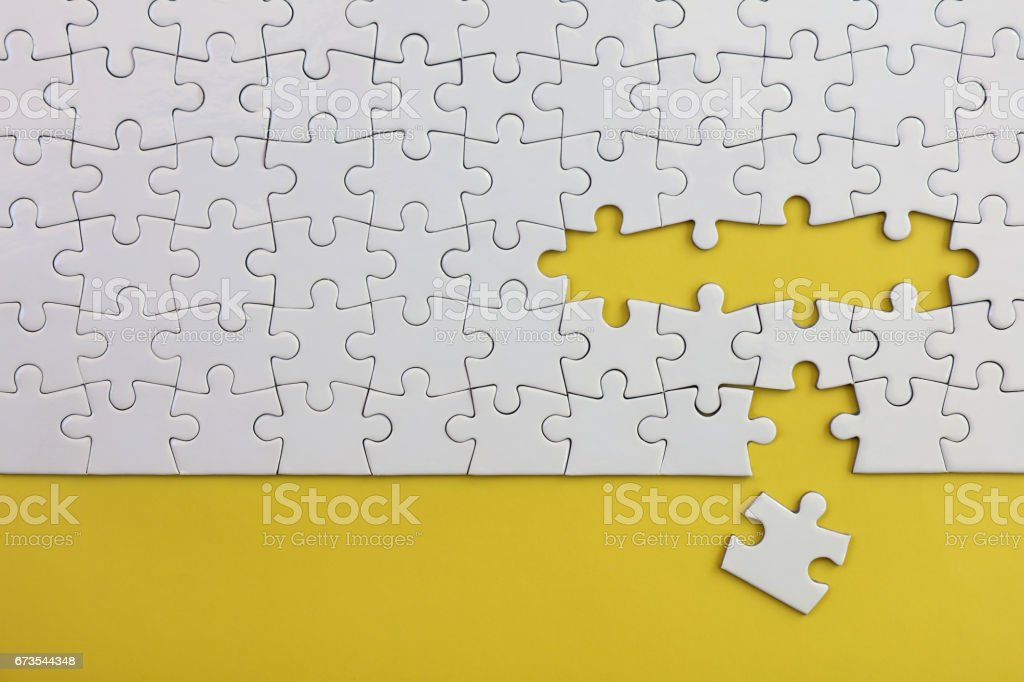 Jigsaw Puzzle on Yellow royalty-free stock photo