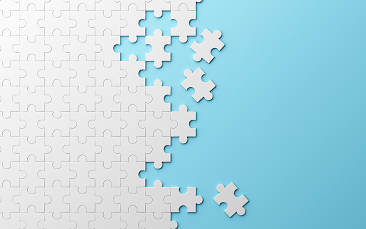 istock Jigsaw puzzle, pattern texture separated on blue background. 3d illustration 980272778
