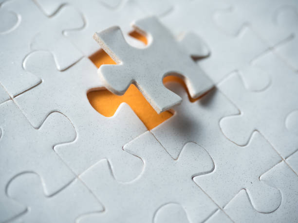 Jigsaw puzzle Jigsaw puzzle jigsaw piece stock pictures, royalty-free photos & images