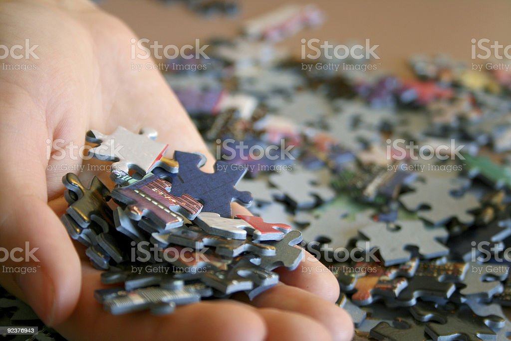 Jigsaw Puzzle Pieces held in hand royalty-free stock photo
