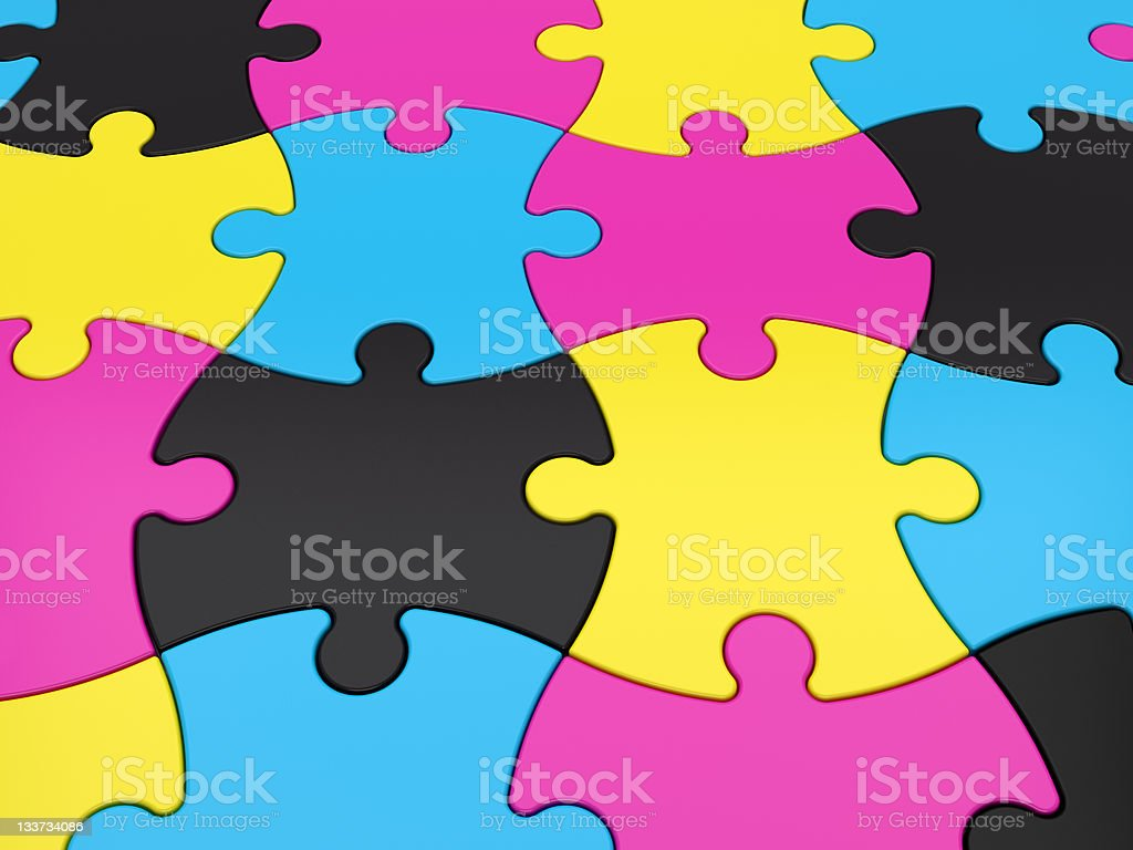 Jigsaw Puzzle Pieces in CMYK Color royalty-free stock photo