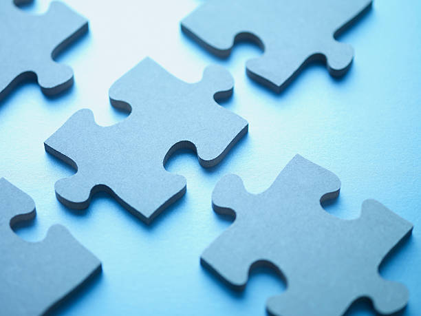 jigsaw puzzle pieces - jigsaw puzzle stock photos and pictures