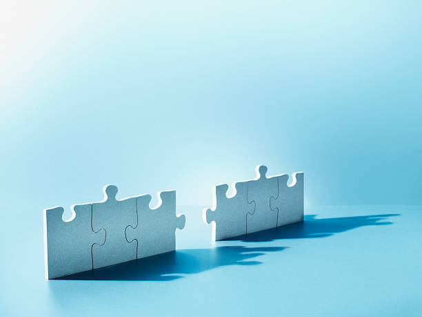 Jigsaw puzzle pieces standing on end stock photo