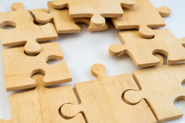 Jigsaw puzzle put on the table show missing one of it - foto stock