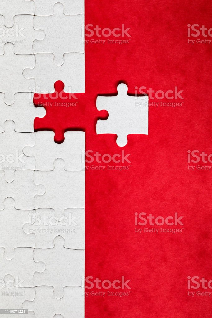 Jigsaw puzzle with missing piece. Missing puzzle pieces. Concept...