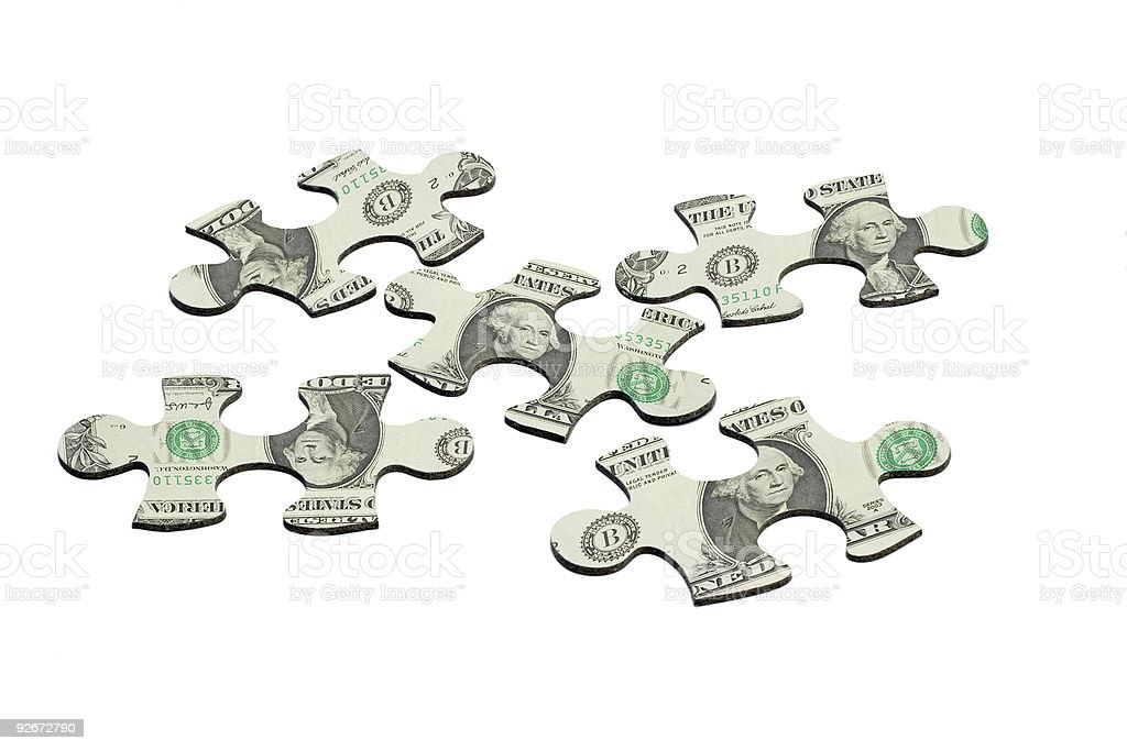 Jigsaw puzzles and US dollar note royalty-free stock photo