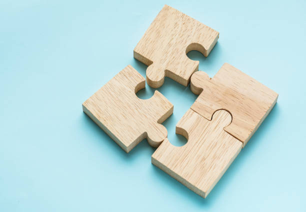 jigsaw teamwork concept macro shot - part of stock pictures, royalty-free photos & images