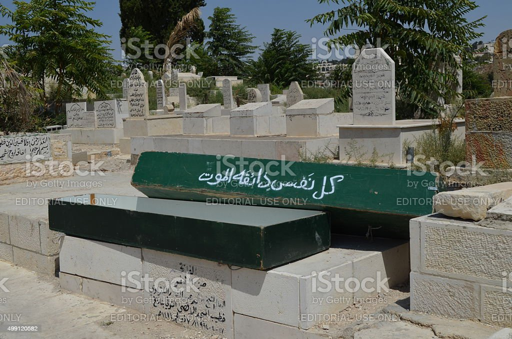 Jihad: Empty Green Coffins and Tombstones at Muslim Cemetery stock photo