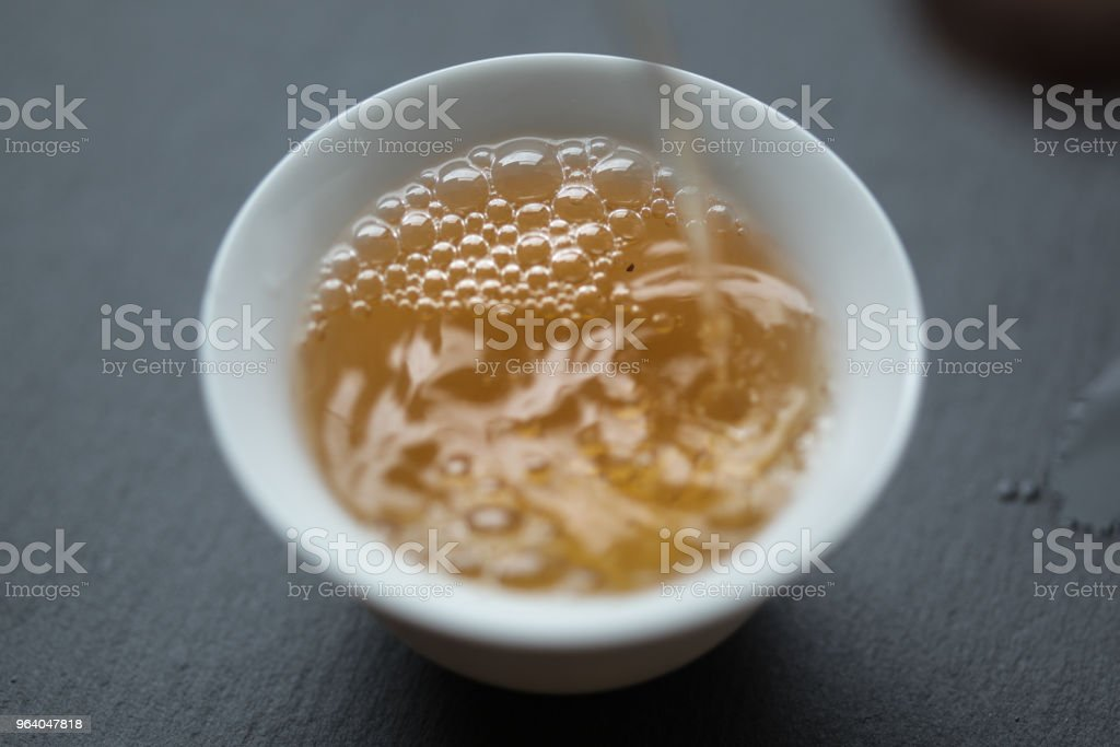 Jin Bian Lan Ma Tou Yan being poured into a teacup - Royalty-free Chinese Tea Stock Photo