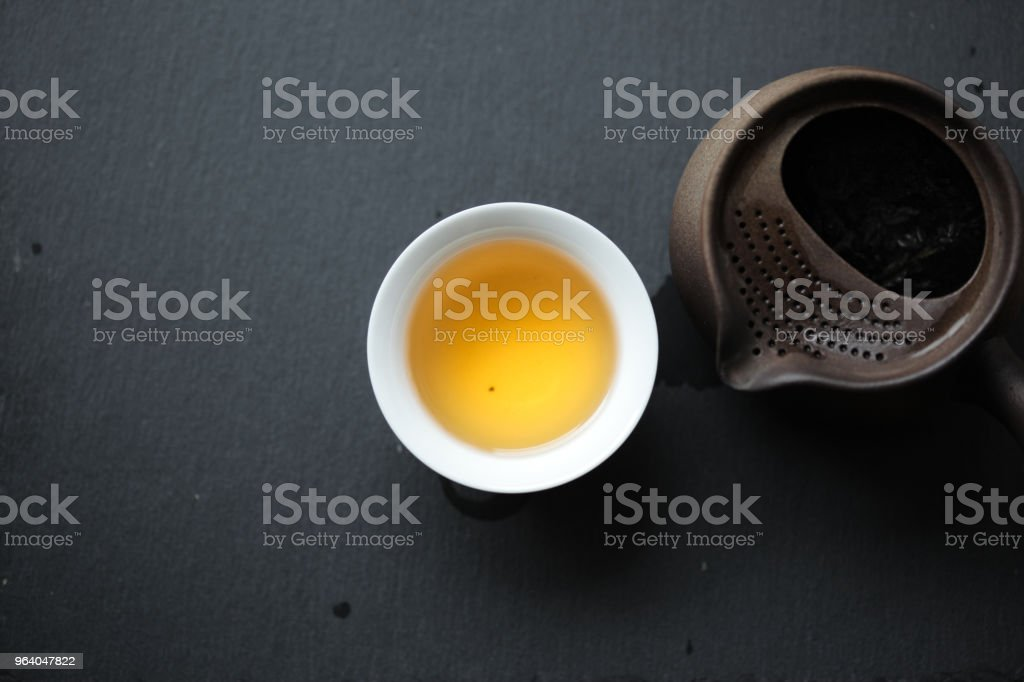 Jin Bian Lan Ma Tou Yan in a white porcelain teacup - Royalty-free Chinese Tea Stock Photo