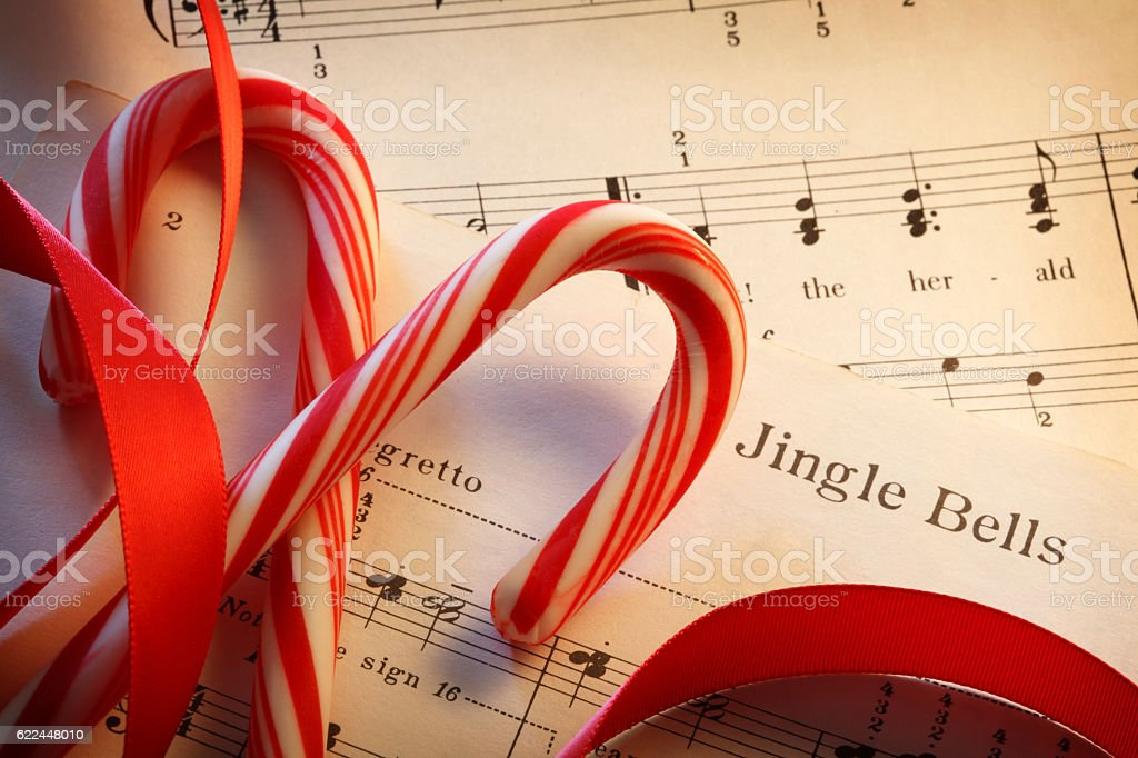 Jingle Bells Sheet Music With Red Ribbon And Candy Canes stock photo