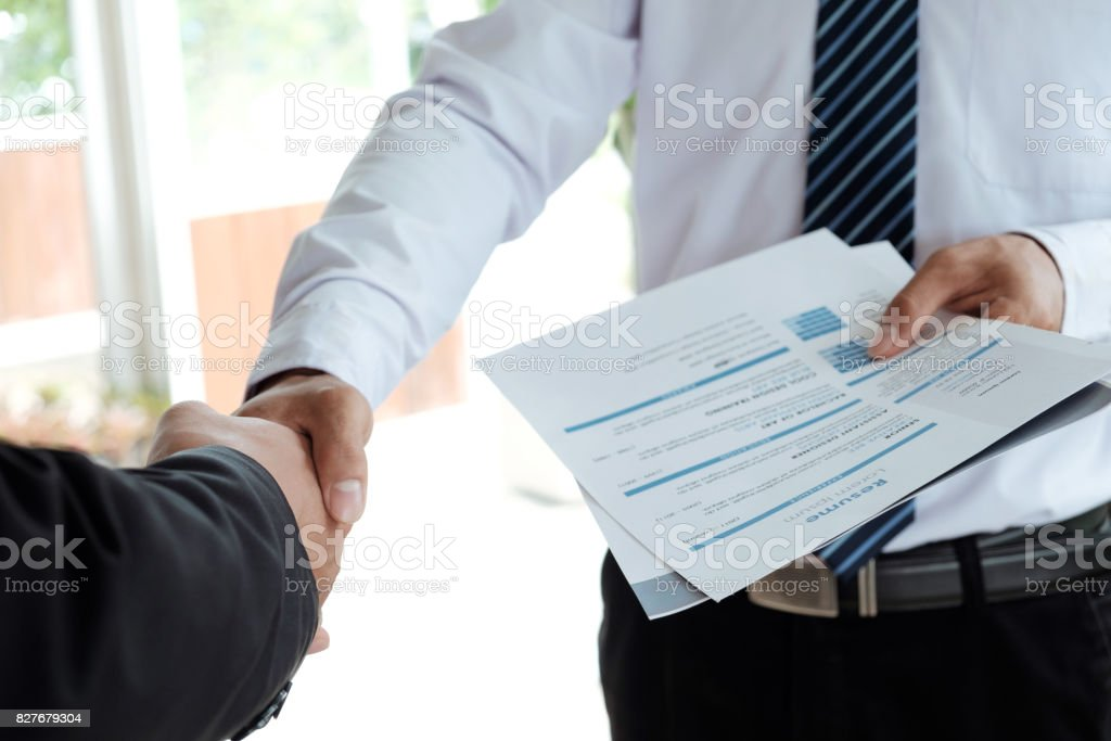 Job applicant having interview. Handshake success job interviewing stock photo