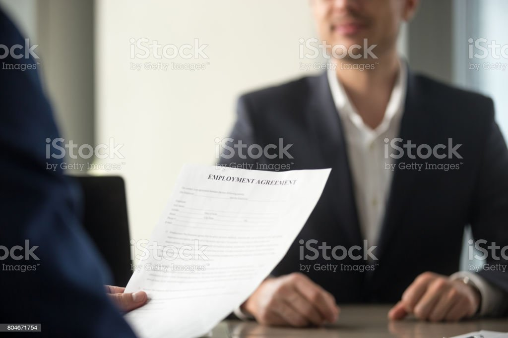 Job Applicant Holding Employment Agreement Considering Work Terms