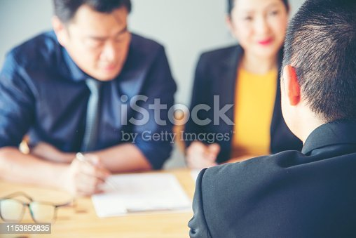 Job applicants having an interview with Human resource manager jobs interview with confident candidate in an office.