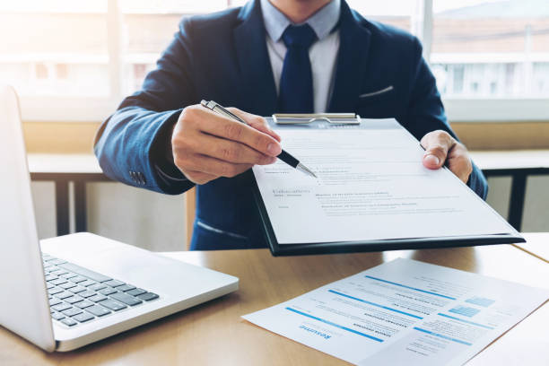 Job application interview, Executive manager filling up the application form to applicant register, Hiring concept stock photo