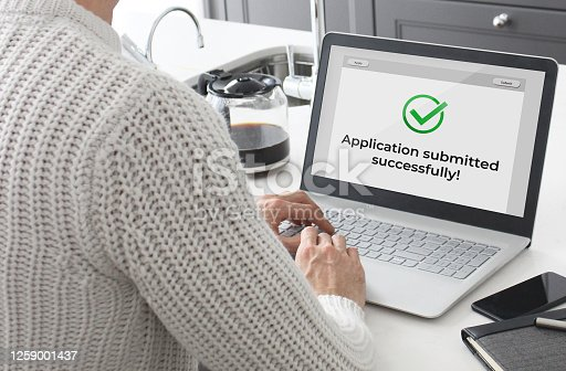 Man submitting an application online.