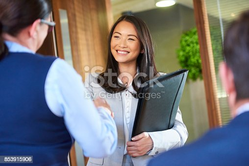istock job candidate smiling as she enters the interview 853915906