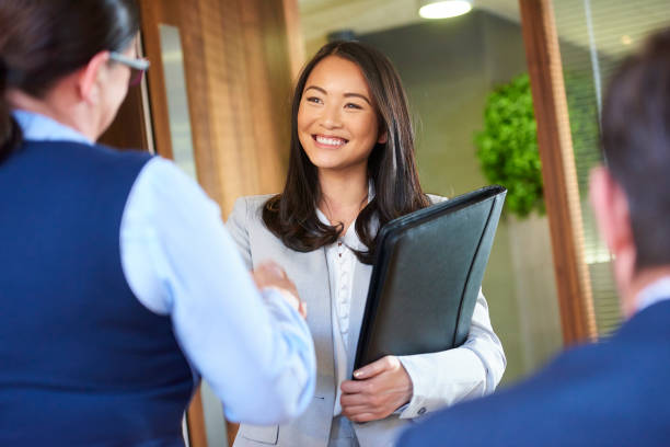 job candidate smiling as she enters the interview - job search stock photos and pictures