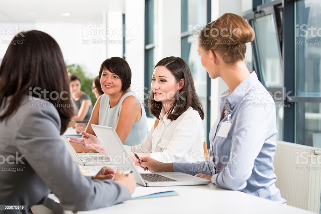 Job fair Group of women attending a job fair, working together and discussing. 2015 Stock Photo