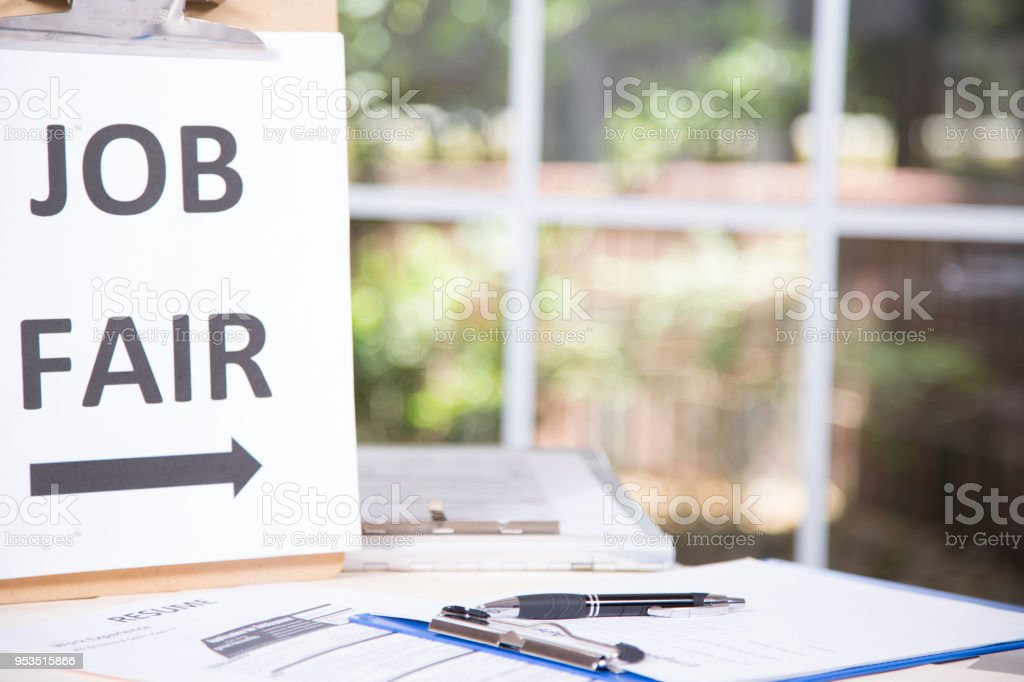 Job fair table with employment applications, resumes. stock photo