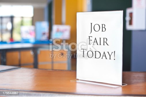 istock Job Fair Today sign at registration table for business event 175544667
