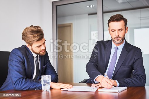636681940istockphoto Job interview concept. Two recruiters checking candidate information during business job interview 1032556956