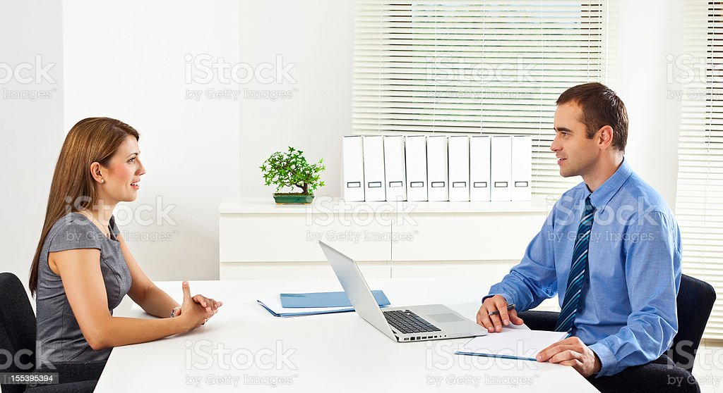 Job interview Young woman having job interview in an office. Achievement Stock Photo