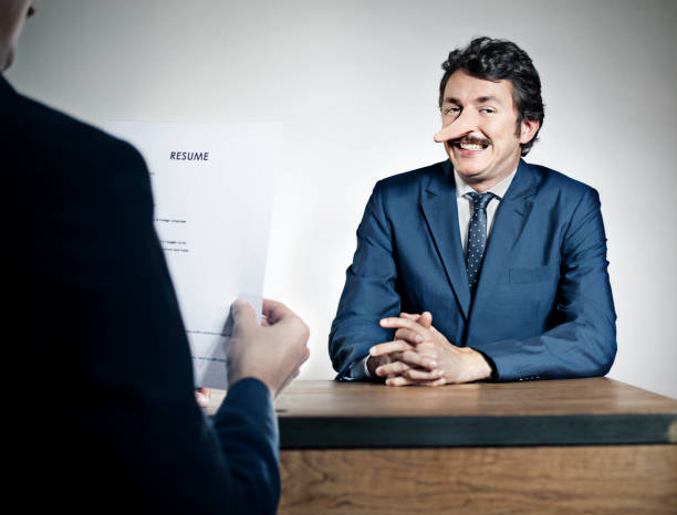 Job interview Man lying in a job interview dishonesty stock pictures, royalty-free photos & images