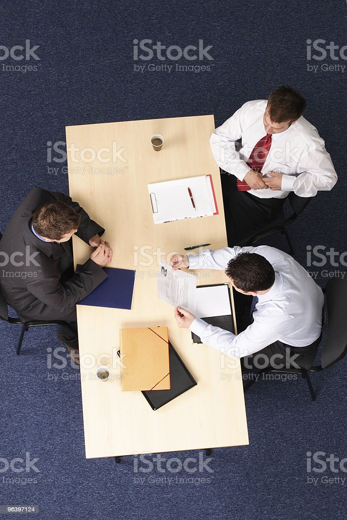 Job Interview - reading resume - Royalty-free Adult Stock Photo