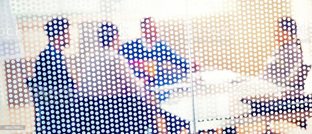 Job interview shot through textured glass wall stock photo