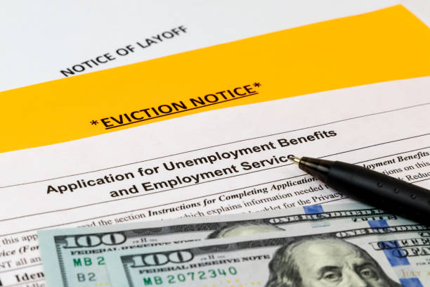 Job layoff notice, application for unemployment insurance benefits, eviction notice. Concept of Covid-19 coronavirus and stay at home order impact on economy stock photo
