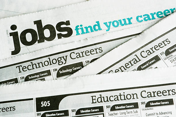 job search and employment, occupation opportunity classified ad newspaper page - job search stock photos and pictures
