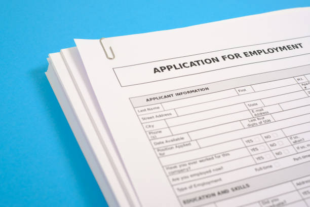 Job search and interview resume recruitment application concept Stack of cv and application for employment on blue desk application form stock pictures, royalty-free photos & images