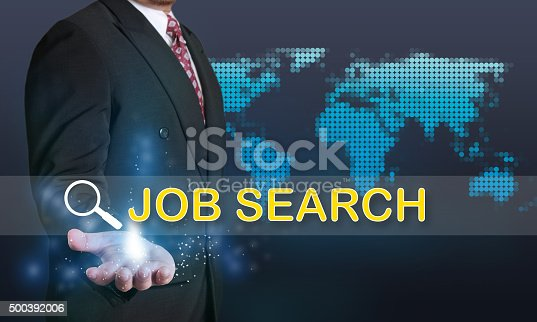 Business concept image of a businessman showing Job Search words on his hand over blue background with dotted world map