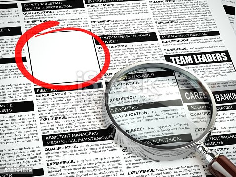istock Job search concept. Loupe, newspaper with employment advertiseme 528394849