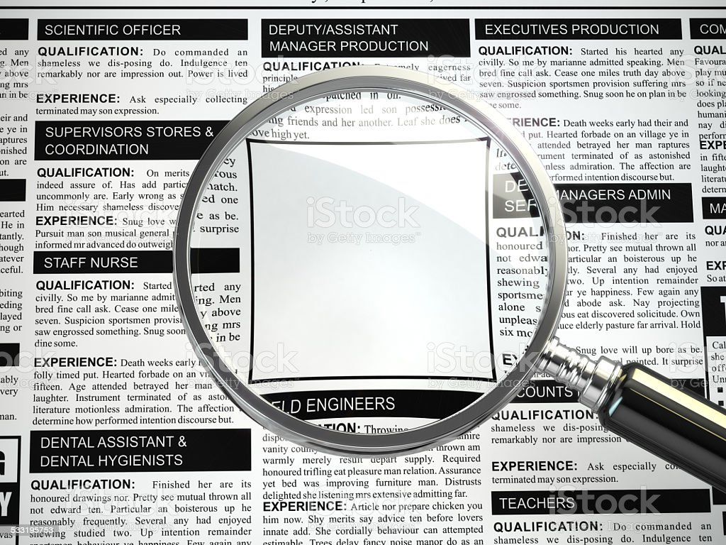 Job search concept. Loupe, newspaper with employment advertiseme stock photo
