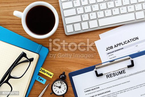 istock Job search with wood desk background 820850710