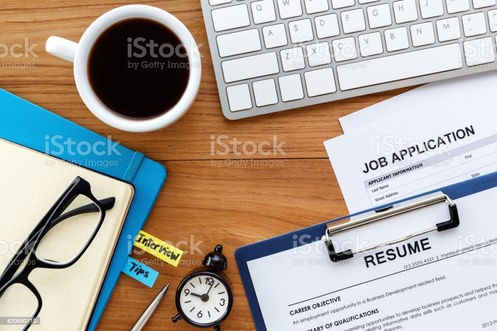 Job search with wood desk background stock photo