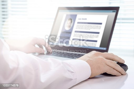 Job seeker and applicant writing his resume and CV with laptop. Modern and visual electronic curriculum vitae in social media. Work experience document in computer screen. Job search and unemployment.