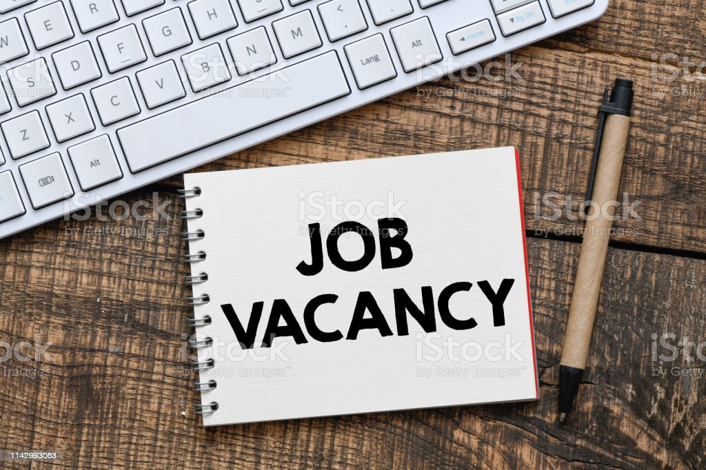 Job vacancy text in a notebook stock photo