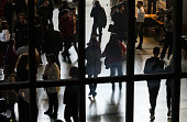 Bucharest, Romania - Novemder 07, 2018: The silhouettes of students are seen through a window at a job fair in Bucharest. This image is for editorial use only.